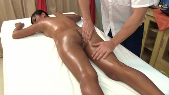 Cute oiled babe gets her firm butt massaged