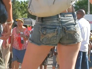 The beautiful denim shorts girls are erotically waving their nice and tight ass cheeks