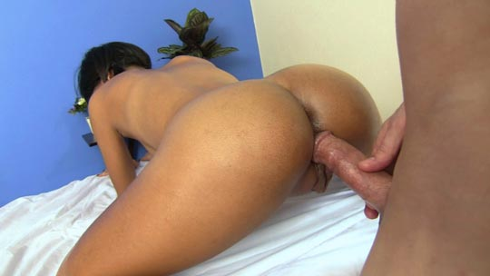 Small Thai girl has her giant clit massage with warm oil